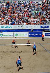 02-06-2012 VOLLEYBAL: EK BEACHVOLLEYBAL: SCHEVENINGEN<br /> (L-R) Richard Schuil, Daan Spijkers, Reinder Nummerdor en Emiel Boersma spelen in een volgepakt The Hague Beach Stadium<br /> ©2012-FotoHoogendoorn.nl