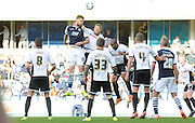 Mark Beevers with a headed chance during the Sky Bet League 1 match between Millwall and Rochdale at The Den, London, England on 26 September 2015. Photo by Michael Hulf.