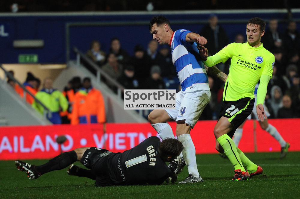QPRs Grant Hall prevents Brighton striker James Wilson, on loan from Manchester United, from getting prosession and Rob Green is able to safely collect the ball during the Queens Park Rangers v Brighton & Hove Albion game in the  Sky Bet Championship on Tuesday 15th Decemeber 2015 at Loftus Road.