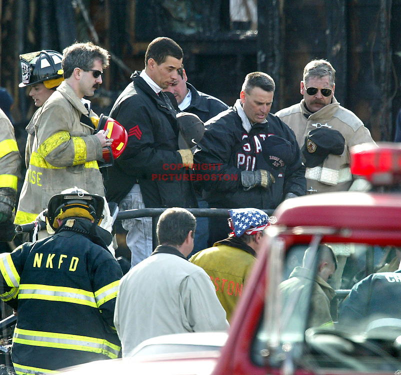 """Last Rights"" Rhode Island Police Firefighters pray as one of the 100 fire victims is pulled from the wreckage of The Station Nightclub.- fragm"