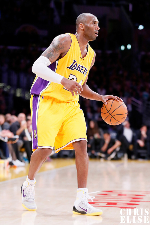 13 January 2014: Los Angeles Lakers guard Kobe Bryant (24) brings the ball up court during the Miami Heat 78-75 victory over the Los Angeles Lakers, at the Staples Center, Los Angeles, California, USA.