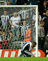 Photo. Jed Wee<br /> Newcastle United v Partizan Belgrade, European Champions League Qualifier, St. James' Park, Newcastle. 27/08/2003.<br /> Newcastle's Aaron Hughes buries his face in his hands after missing the vital penalty.