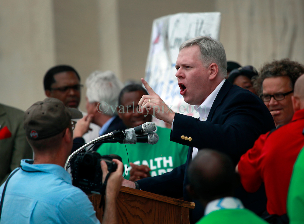 30 April 2013. Baton Rouge, Louisiana,  USA. .March on Baton Rouge, Enough is Enough. .Dayne Sherman, writer and speaker addresses a coalition of 40 Louisiana Organisations protesting what many believe to be the 'Economic and fiscal disaster that is the administration of Governor Bobby Jindal.' Top of the agenda,  Jindal's refusal to accept the expansion of MEDICAID, instead denying coverage to over 400,000 citizens with Jindal refusing to accept federal funding for  'Obamacare.' Slashed state spending on education, social services and critical community based organisations is having far reaching and devastating effects on ordinary and poor citizens in Louisiana..Photo; Charlie Varley.