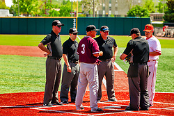 20 May 2019:  Ken Henderson and Steve Holm meet at the plate to exchange line up cards with umpires Home Plate: Greg Harmon, First: Tim Catton, Second Base: Tim Winningham, Third Base: Jason Stidham. Missouri Valley Conference Baseball Tournament - Southern Illinois Salukis v Illinois State Redbirds at Duffy Bass Field in Normal IL<br /> <br /> #MVCSPORTS