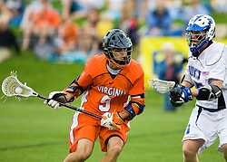 Virginia attackman Danny Glading (9) is defended by Duke defenseman Parker Mckee (35).  The #2 ranked Duke Blue Devils defeated the #3 ranked Virginia Cavaliers 11-9 in the finals of the Men's 2008 Atlantic Coast Conference tournament at the University of Virginia's Klockner Stadium in Charlottesville, VA on April 27, 2008.
