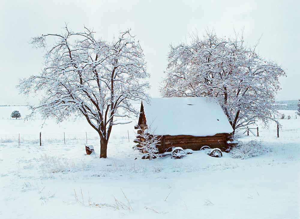 Snow covers a small cabin and surrounding trees near Zion NP, Utah.