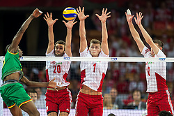06.09.2014, Jahrhunderthalle, Breslau, POL, FIVB WM, Kamerun vs Polen, Gruppe A, im Bild Mateusz Mika poland #20 Piotr Nowakowski poland #1 Mariusz Wlazly poland #10 // Mateusz Mika poland #20 Piotr Nowakowski poland #1 Mariusz Wlazly poland #10 // during the FIVB Volleyball Men's World Championships Pool A Match beween Cameroon and Poland at the Jahrhunderthalle in Breslau, Poland on 2014/09/06. EXPA Pictures © 2014, PhotoCredit: EXPA/ Newspix/ Sebastian Borowski<br /> <br /> *****ATTENTION - for AUT, SLO, CRO, SRB, BIH, MAZ, TUR, SUI, SWE only*****