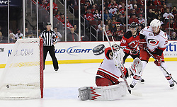 Feb 16; Newark, NJ, USA; New Jersey Devils left wing Ilya Kovalchuk (17) scores a goal past Carolina Hurricanes goalie Cam Ward (30) during the second period at the Prudential Center.