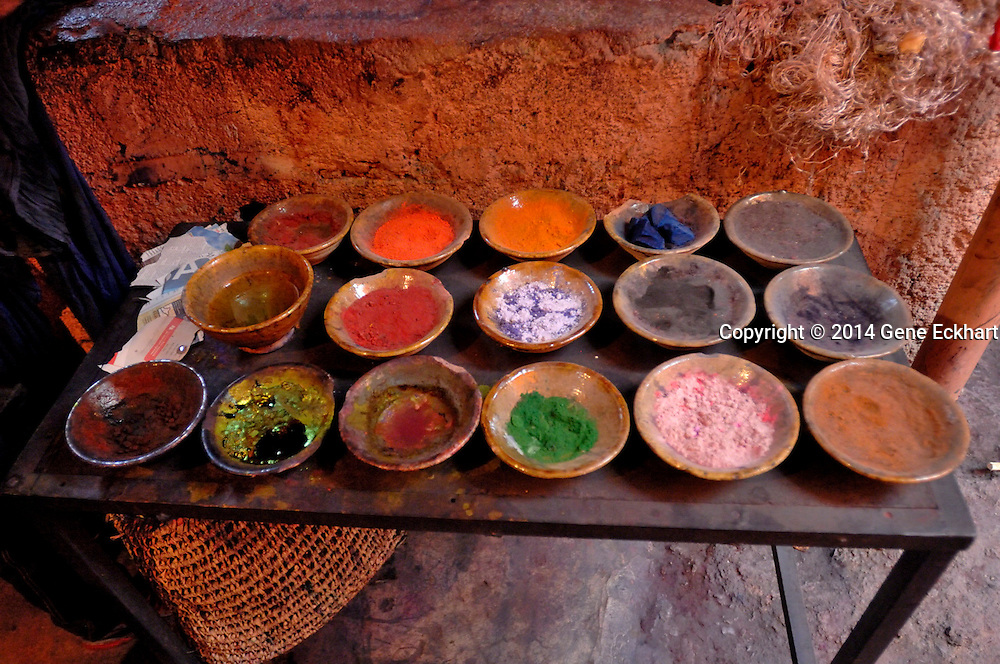 This table full of dyes is in a silk dyeing factory in the medina (old city) in Marrakech, Morocco.