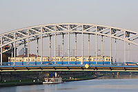 old tram seen crossing pilsudski bridge from krakow's kazimierz district to podgorze in sunshine in september 2005