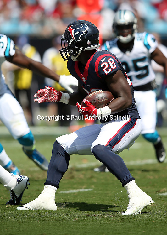 Houston Texans running back Alfred Blue (28) runs the ball in the first quarter during the 2015 NFL week 2 regular season football game against the Carolina Panthers on Sunday, Sept. 20, 2015 in Charlotte, N.C. The Panthers won the game 24-17. (©Paul Anthony Spinelli)