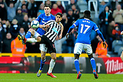 Ayoze Perez (#17) of Newcastle United contests the ball in the air with Michael Keane (#4) of Everton during the Premier League match between Newcastle United and Everton at St. James's Park, Newcastle, England on 9 March 2019.