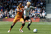 Hull City midfielder Ahmed Elmohamady and Derby County midfielder Will Hughes tussle during the Sky Bet Championship play-off first leg match between Derby County and Hull City at the iPro Stadium, Derby, England on 14 May 2016. Photo by Alan Franklin.
