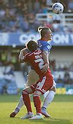 Sebastian Polter holds off Scott Malone during the Sky Bet Championship match between Queens Park Rangers and Cardiff City at the Loftus Road Stadium, London, England on 15 August 2015. Photo by Andy Walter.