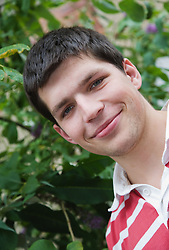 Portrait of young Czech man looking downwards,