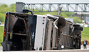 An overturned Cardinal Coach Line charter bus on Hwy. 161 near N. Belt Line Rd.  in Irving on Thursday, April 11, 2013. The accident resulted in two deaths and 41 hospitalized. (Cooper Neill/The Dallas Morning News)