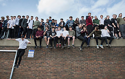 © Licensed to London News Pictures. 04/03/2017. Guildford, UK. Free runners sit on a wall during a memorial to remember Nye Newman who died in January. Nye Newman, whose death is thought not to be related to Parkour, died in Paris. Free running or Parkour involves jumping and climbing on building, railings and walls.  Photo credit: Peter Macdiarmid/LNP