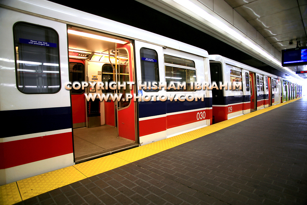 Subway train waiting in a subway station with doors open, Vancouver, BC, Canada