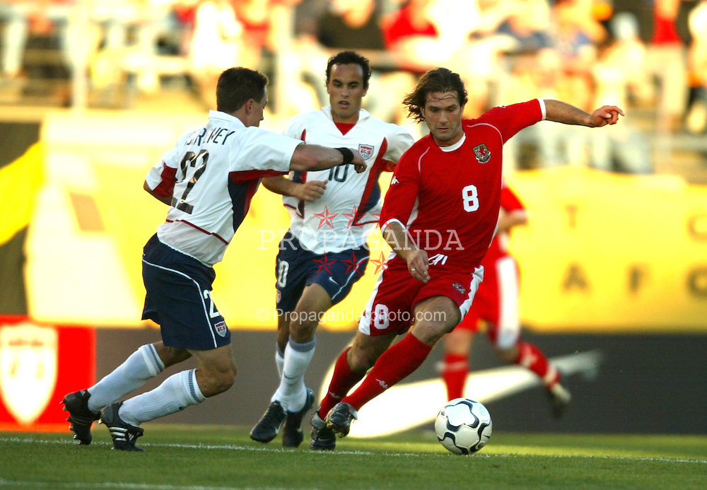 SAN JOSE, USA - Tuesday, May 27, 2003: Wales' Andy Johnson takes on USA's Richard Mulrooney during the Friendly International match at the Spartan Stadium. (Pic by David Rawcliffe/Propaganda)