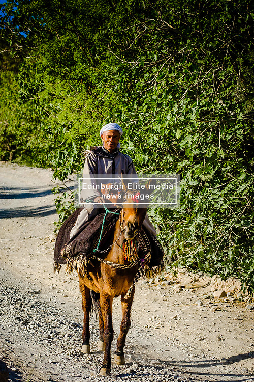 A berber man on horse back makes his way along the track through the M'Goun Gorge n M'goun Amazigh territory, Morocco<br /> <br /> (c) Andrew Wilson | Edinburgh Elite media