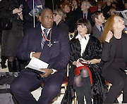 Andre Leon Talley and Anna Wintour. Yves St. Laurent. last couture collection, 1962-2002. Pompidou Centre. Paris. 22 January 2002. © Copyright Photograph by Dafydd Jones 66 Stockwell Park Rd. London SW9 0DA Tel 020 7733 0108 www.dafjones.com