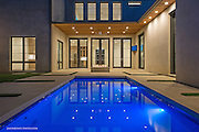 Minimalist custom swimming pool, at a new custom built modern home, with custom lighting and landscaping architecture. Inspired by Glenn Murcutt Architecture style