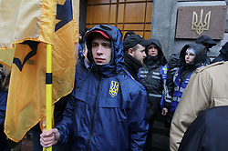 March 27, 2019 - Kiev, Ukraine - Supporters of the Ukrainian far-right party National Corps attend a rally calling to the Security Service to react to the Ukrainian presidential candidate Yuri Boyko and Ukrainian politician Viktor Medvedchuk's recent visit to the Russia, near the Security Service building in Kiev, Ukraine, on 27 March, 2019. Ukrainian far-right party National Corps supporters gathered for their protest against visit of the Ukrainian presidential candidate Yuri Boiko and Ukrainian politician Viktor Medvedchuk in Russia and their negotiation with Russian Prime Minister Dmitry Medvedev, that took place on 22 March, 2019. The presidential election will held in Ukraine on March 31, 2019. (Credit Image: © Str/NurPhoto via ZUMA Press)