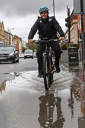 © Licensed to London News Pictures. 25/09/2019. London, UK. A cyclist rides through a large puddle of rainwater on Green Lanes in north London following heavy downpour early this morning. Photo credit: Dinendra Haria/LNP Photo credit: Dinendra Haria/LNP