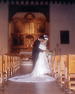 Romantic pose of the bride and groom in church.