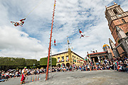 The famous Voladores de Papantla, the Papantla Flyers, perform their ancient Mesoamerican ceremony in the Jardin Allende during the week long fiesta of the patron saint Saint Michael in San Miguel de Allende, Mexico.