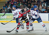 KELOWNA, CANADA - NOVEMBER 23:  Colton Sissons #15 of the Kelowna Rockets is checked by Tye Hand #2 of the  Regina Pats at the Kelowna Rockets on November 23, 2012 at Prospera Place in Kelowna, British Columbia, Canada (Photo by Marissa Baecker/Shoot the Breeze) *** Local Caption ***