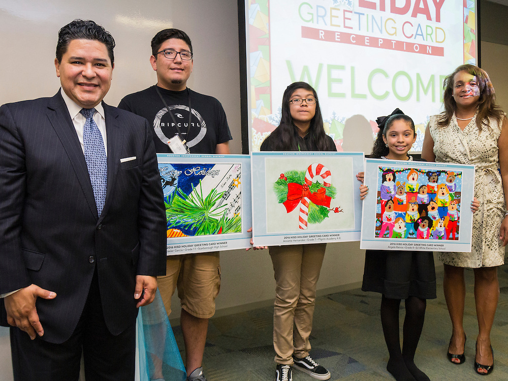 All three HISD holiday greeting card artwork winners pose with Superintendent Richard Carranza and HISD Trustee Rhonda Skillern-Jones.