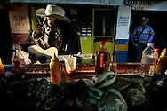 A street musician sings while at an Oyster stand in Tijuana, Mexico.  The Justice Dept.has issued a warning to travelers to avoid parts of Northern Mexico due to an ongoing Drug war that has claimed  over 7,000 lives sine January of 2007.