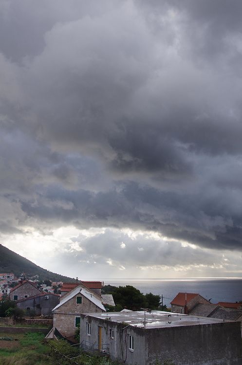 View of storm clouds south from guesthouse in the hills above Bol Town, Brač Island, Croatia