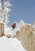 Scott Sady jumping off the rocks under the Blazing Zephyr on a powder day at Mt. Rose Ski Tahoe.