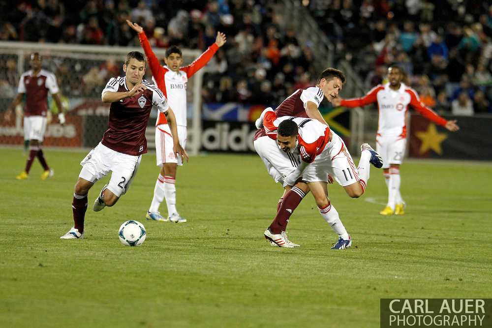 May 4th, 2013 Commerce City, CO - Toronto FC midfielder Luis Silva (11) is fouled by Colorado Rapids midfielder Shane O'Neill (27) as Rapids midfielder Nathan Sturgis (24) chases the ball in the second half of the MLS match between the Toronto FC and the Colorado Rapids at Dick's Sporting Goods Park in Commerce City, CO