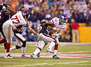 INDIANAPOLIS, IN - FEBRUARY 05:  Eli Manning #10 of the New York Giants is sacked by  Mark Anderson #95 of the New England Patriots during Super Bowl XLVI at Lucas Oil Stadium on February 5, 2012. (Photo by Tom Hauck)