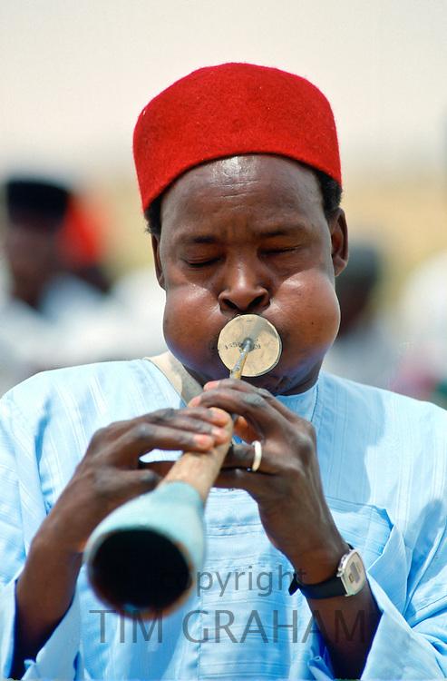 Musician playinga  traditional wind instrument, Nigeria