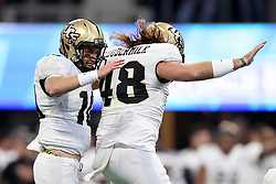 UCF Knights quarterback McKenzie Milton (10) celebrates a touchdown with punter Mac Loudermilk (48) during the 2018 Chick-fil-A Peach Bowl NCAA football game against the Auburn Tigers on Monday, January 1, 2018 in Atlanta. (Jason Parkhurst / Abell Images for the Chick-fil-A Peach Bowl)