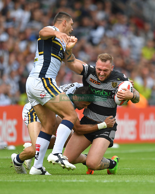 Hull FC's Josh Griffin is tackled by Leeds Rhinos' Joel Moon and Jimmy Keinhorst during the Challenge Cup Semi Final match at The Keepmoat Stadium, Doncaster.