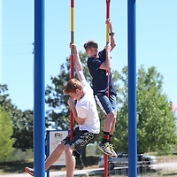 Lauren Wood | Buy at photos.djournal.com<br /> Johnny Carpenter, 14, left, and Liam Medlock, 12, demonstrate climbing up a pole during a Project Fit America assembly Friday afternoon at Hills Chapel School in Booneville.