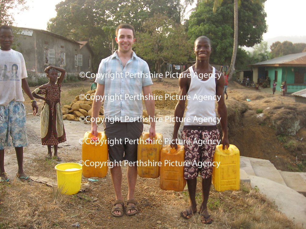 Ben Kirley Volunteer Work in Sierra Leone.....30.07.12<br /> Ben Kirley carrying water from the well to home with Amara Sannoh<br /> Picture by Graeme Hart.<br /> Copyright Perthshire Picture Agency<br /> Tel: 01738 623350  Mobile: 07990 594431