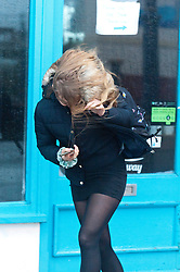 © Licensed to London News Pictures. 14/01/2020. Porthcawl, Bridgend, Wales, UK. A young woman battles against the gale force winds in the small Welsh seaside resort of Porthcawl in Bridgend, UK. on the day following Storm Brendan's arrival on the south Welsh coastline, Photo credit: Graham M. Lawrence/LNP