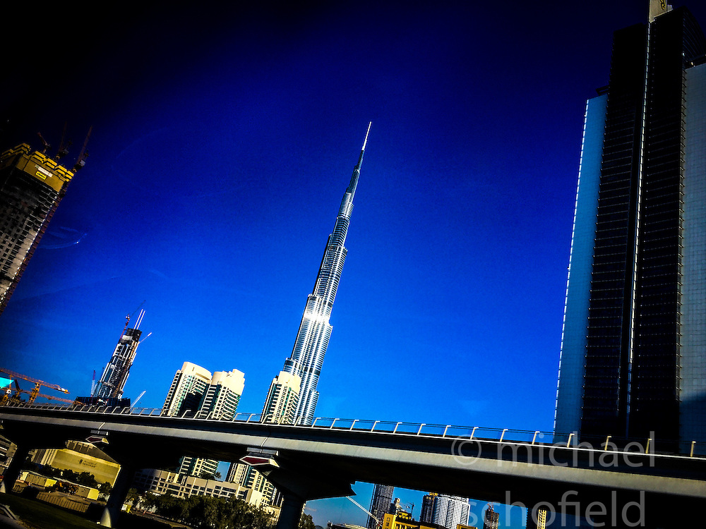 Pic of construction and skyscrapers, with the Burj Khalifa, the world's tallest building, in Dubai. Images from the MSC Musica cruise to the Persian Gulf, visiting Abu Dhabi, Khor al Fakkan, Khasab, Muscat, and Dubai, traveling from 13/12/2015 to 20/12/2015.