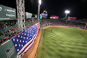 10/23/13 — BOSTON — An American flag is unfurled during the National Anthem at Fenway Park before Game 1 of the World Series on Oct. 23, 2013.