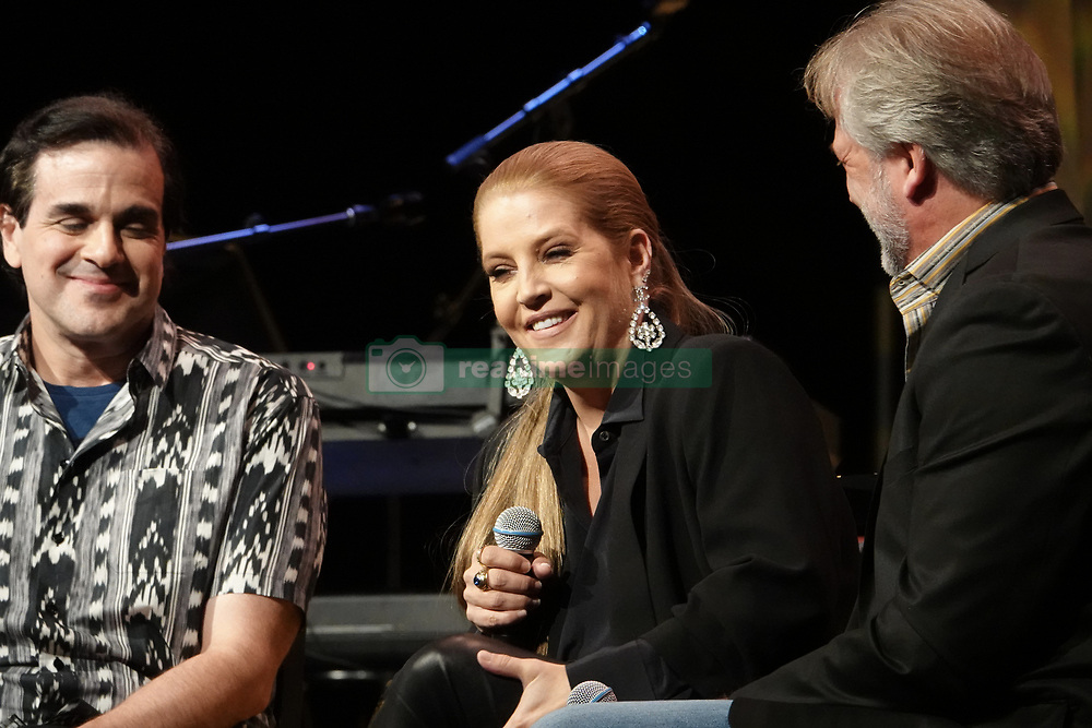 Andy Childs, Joel Weinshanker (left) (managing owner of EPE), and Lisa Marie Presley took the stage at Elvis Presley's Memphis at Graceland on Saturday to discuss the release of the latest album Where No One Stands Alone. Elvis and Lisa Marie Presley sing duet on 'new' Elvis gospel album. Photo by © Karen Pulfer Focht. 11 Aug 2018 Pictured: Andy Childs, Joel Weinshanker (left) (managing owner of EPE), and Lisa Marie Presley took the stage at Elvis Presley's Memphis at Graceland on Saturday to discuss the release of the latest album Where No One Stands Alone. Elvis and Lisa Marie Presley sing duet on 'new' Elvis gospel album. Photo by © Karen Pulfer Focht. Photo credit: Karen Pulfer Focht / MEGA TheMegaAgency.com +1 888 505 6342