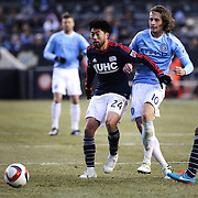 Lee Nguyen, (left), New England Revolution, is challenged by Mix Diskerud, NYCFC, during the New York City FC v New England Revolution, inaugural MSL football match at Yankee Stadium, The Bronx, New York,  USA. 15th March 2015. Photo Tim Clayton