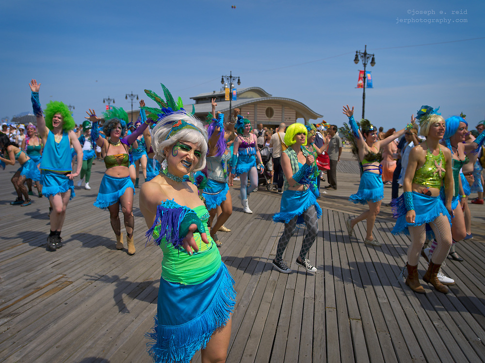 Brooklyn, NY, US, June 22, 2013.  Participants in colorful costumes walking in the annual Mermaid Parade on the boardwalk on Coney Island.