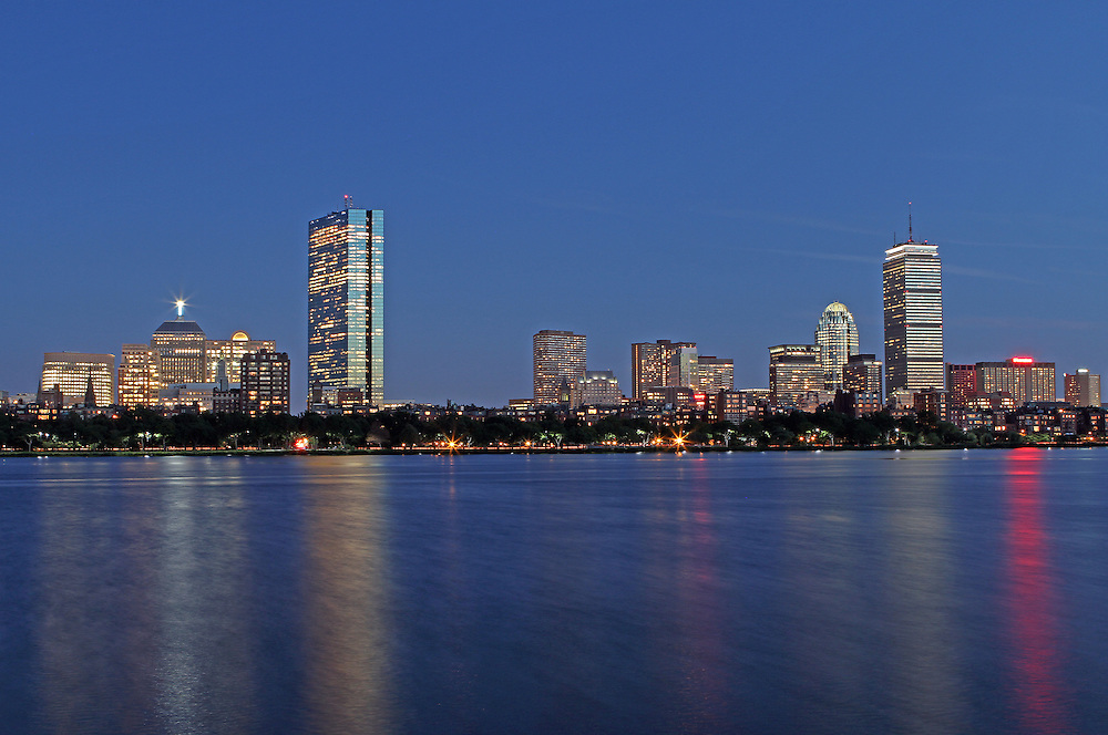 Boston skyline photography image showing the Boston Charles River with its iconic Boston landmarks such as the John Hancock Tower, Prudential Center and Brownstones on its banks.<br />