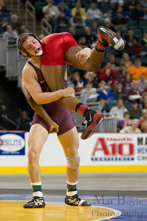 Raamiah Bethea (red) of Trenton Central defeats Sal Mastriani of Don Bosco Prep in the 152lb weight class NJSIAA state wrestling final held at Boardwalk Hall in Atlantic City NJ on March 4, 2012. Bethea had an undefeated season clenching his 37 victory this year. (photo / Mat Boyle)